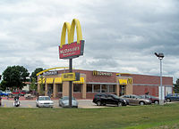 """An American McDonald's in Mount Pleasant, Iowa in June 2008; this is an example of the """"new"""" look of American McDonald's restaurants"""
