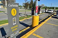 A curbside pickup at a McDonald's drive-thru during the COVID-19 pandemic