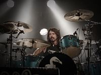 Grohl performing with Them Crooked Vultures in August 2009