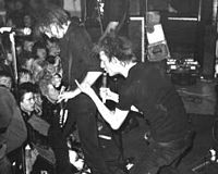 """Crass were the originators of anarcho-punk. Spurning the """"cult of rock star personality"""", their plain, all-black dress became a staple of the genre."""