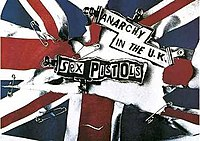 """The Sex Pistols' """"Anarchy in the U.K."""" poster—a ripped and safety-pinned Union Flag. Jamie Reid's work had a major influence on punk style and contemporary graphic design in general."""