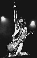 Jimmy Page performing onstage in 1977