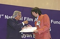 Nigam (right) receiving the National Film Award for Best Male Playback Singer from President A. P. J. Abdul Kalam (left), 2005.