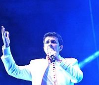 Nigam performing at the live concert in 2014