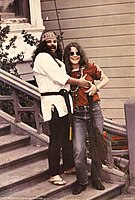 """Janis and Ron """"Pigpen"""" McKernan on the steps of 715 Ashbury"""