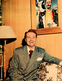 Skelton at home with one of his clown paintings in 1948