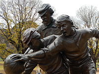Statue outside the Melbourne Cricket Ground commemorating the origins of Australian rules football