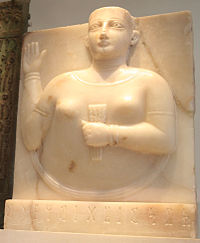 A Sabaean gravestone of a woman holding a stylized sheaf of wheat, a symbol of fertility in ancient Yemen