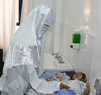 A Yemeni doctor examines an infant in a USAID-sponsored health care clinic