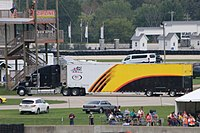 The Ken Schrader Racing hauler driving through the infield at Road America. Notice that it still has the Menards design from 2016 only with the logos taken off.