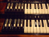 Preset keys on a Hammond organ are reverse-colored and sit to the left of the manuals