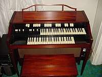 The L-100 spinet was particularly popular in the UK.