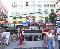 The entrance to Chueca metro station in the Plaza de Chueca (Chueca square) in Madrid, during gay pride week.