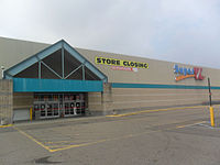 A Super Kmart Center store with Super Kmart signage in Southgate, Michigan in July 2014. As indicated on the banner, this store began a liquidation sale one month earlier and closed on October 12, 2014.