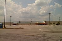 The exterior of the first Super Kmart Center store in Medina, Ohio, as it appears after its closure in 2012