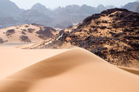 Sand dunes, rocks, and mountains in Tadrart Acacus, a desert area in southwestern Libya, part of the Sahara