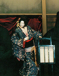 The character Osono from the play Hade Sugata Onna Maiginu{{efn|1=in a performance by the Tonda Puppet Troupe of Nagahama, Shiga, Japan - an example of Japanese bunraku puppetry}}