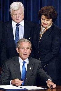 Kennedy at the 2002 signing of a border security bill, with Senator Dianne Feinstein and President George W. Bush