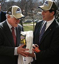 Kennedy and Pennsylvania Senator Rick Santorum after Super Bowl XXXIX in 2005, where the Patriots defeated the Eagles. Here Santorum wears a Patriots hat and presents Kennedy a bag of Philly cheesesteaks.
