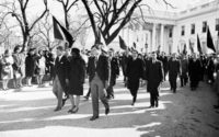 Ted Kennedy, accompanied by his brother Robert and sister-in-law Jacqueline, walks from the White House for the funeral procession accompanying President Kennedy's casket to Cathedral of St. Matthew the Apostle.