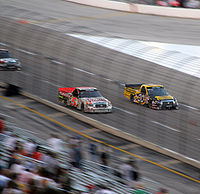 Todd Bodine (right) racing fellow Truck Series champion Mike Skinner in 2007.