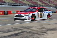 Ryan Blaney driving the iconic No. 21 Wood Brothers Ford in 2016 at Michigan International Speedway