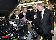 Mulally (second from left) with then-President George W. Bush at the Kansas City Assembly plant in Claycomo, Missouri on March 20, 2007, touting Ford's new hybrid cars