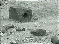 Lumps of graphite moderator ejected from the core; the largest lump shows an intact control rod channel