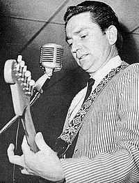 Nelson performing on a Grand Ole Opry package show in 1965