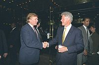 Future president Donald Trump and Clinton shaking hands at Trump Tower, June 2000
