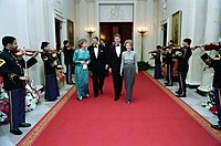 Governor and Mrs. Clinton attend the Dinner Honoring the Nation's Governors in the White House with President Ronald Reagan and first lady Nancy Reagan, 1987.