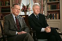 Former president George H. W. Bush and Clinton in the White House Library, January 2005