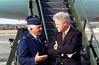 Col. Paul Fletcher, USAF and Clinton speak before boarding Air Force One, November 4, 1999.