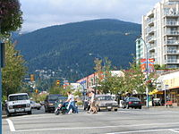 Main thoroughfare Lonsdale Avenue with Mount Fromme in the background