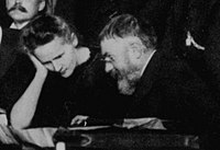Marie Curie and Poincaré talk at the 1911 Solvay Conference