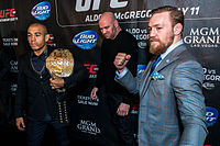 Aldo (left) and Conor McGregor (right) pose for photos during the UFC 189 press conference in London.
