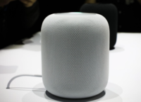 A white HomePod on display
