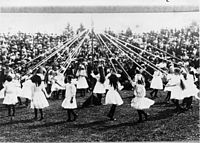 May Day celebrations in 1913. Young girls dance around a maypole.