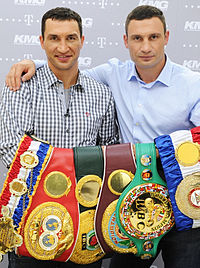 Wladimir and Vitali with every title in the heavyweight division, 2012. Left to right: The Ring, IBF, IBO, WBO, WBC, and WBA.