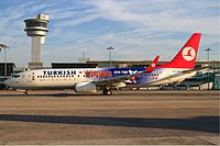 A Turkish Airlines Boeing 737-800 in 2010 FIBA World Championship livery at Istanbul Atatürk Airport.