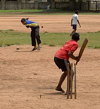 Cricket being played in India. British sports continue to be supported in various parts of the former empire.