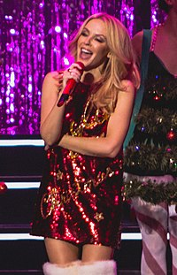 """Kylie Minogue scored her second number one of the decade with """"Can't Get You Out of My Head"""" in 2001, selling more than 1.1 million copies. It was the biggest-selling single by a female of the 21st century until 2011, when it was surpassed by Adele's """"Someone like You""""."""