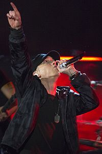 Rapper Eminem scored 7 number-one hits in 2000s, putting him second behind Westlife for the most number-ones during the decade.