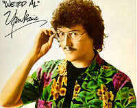"""Yankovic's """"classic"""" look before eye surgery: with glasses, mustache and short, curly hair; used from 1979 to 1998"""