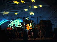 """Stevens performing in Waikiki Shell, Oahu, Hawaii, 1974. The stage decor reflects his song, """"Boy with a Moon & Star on His Head"""" from Catch Bull at Four."""