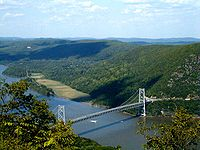 The Bear Mountain Bridge across the Hudson River, as seen from Bear Mountain. It connects the northern parts of Westchester and Rockland Counties, considered by some to be the southeastern edge of Upstate.