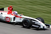 Button behind the wheel for BAR at the 2004 United States Grand Prix.