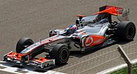 Button's first race for McLaren was the 2010 Bahrain Grand Prix.