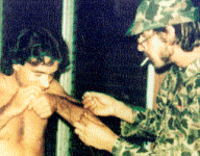 Carlos Lehder (left) snorting cocaine with former prison mate Steven Yakovac on Norman's Cay (1976)