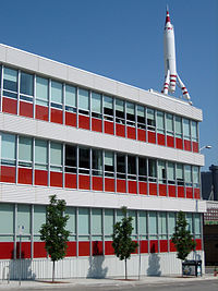The TWA Moonliner atop the Former TWA Building is a landmark in the Crossroads Art District. The building is now the headquarters for Barkley.